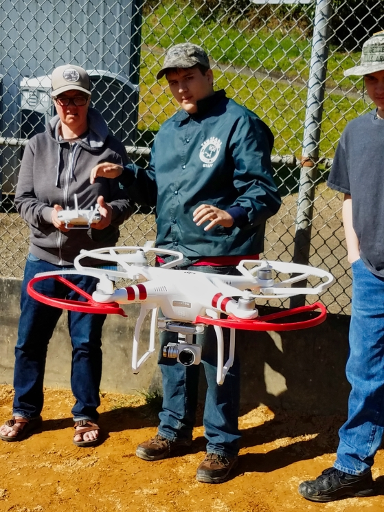 Career Tech HS students and drone crew chief flying obstacle course with Phantom 3 at Lincoln City ball park